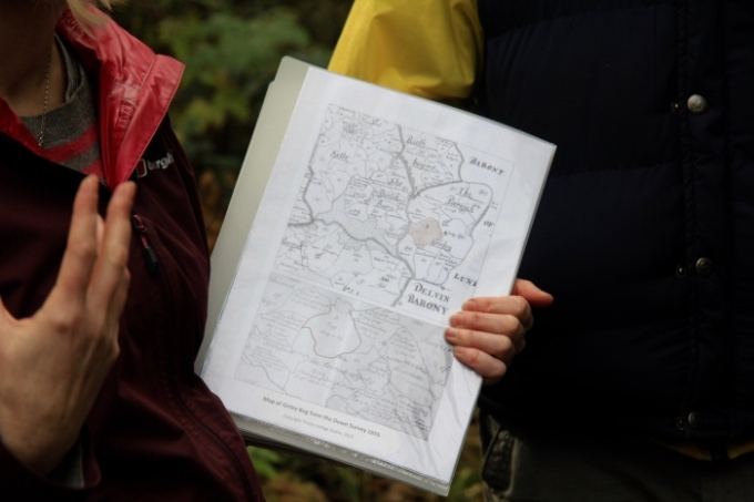 Kate showing us old maps of Girley bog - its 300 acres; these are great for bog tours